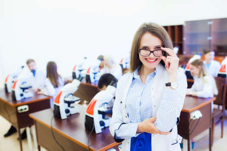 healthcare and health. Attractive female doctor in front of medical group