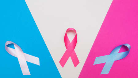 multicolored ribbons supporting cancer patients. The concept of the feast of the fourth of February Stock Photo