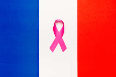 Pink ribbon awareness for aids day concept. France world organization.