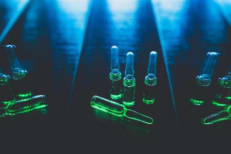 liquid drug production concept. artistic dark filter. low key photo