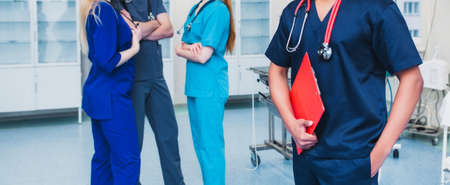 medicine professionals staff. people - doctor, nurse and surgeon. a group of faceless doctors. medical advertisement design. background wide promotional banner. 版權商用圖片
