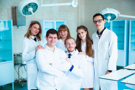 Medical students profession staff. multinational people - doctor, nurse and surgeon. A group of graduates of a medical university in a surgical room. Nursing School Reklamní fotografie
