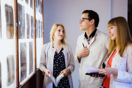group of doctor studying the sections of the brain. The concept of health education. Students in the classroom with X-rays