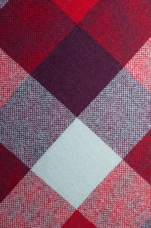 Textured fabric with a pattern of squares of different shades Stock Photo