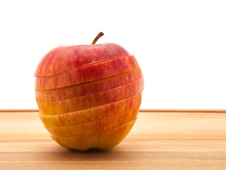A delicious juicy apple for baking on a wooden table.