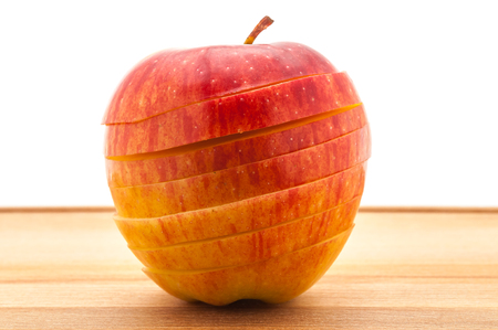 Close-up A delicious juicy apple for baking cut across on a wooden table. Stock Photo