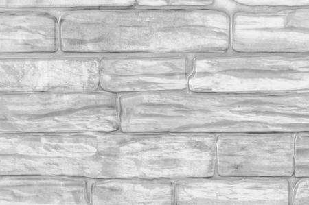 Wall from rectangular bricks close-up black and white. Banco de Imagens