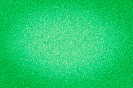 The granite texture is a bright green color with small dots, with vignetting.