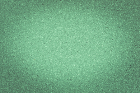 Texture of granite green color with small dots, with vignetting.