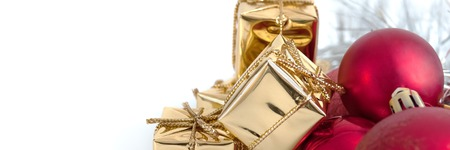 Merry Christmas, New Year, gifts in gold boxes, red Christmas balls in the right corner. White background