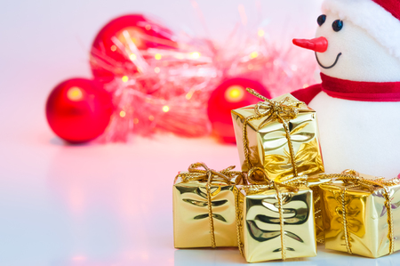 Merry Christmas, New Year, snowman, gifts in gold boxes and red balls on a white background Stock Photo