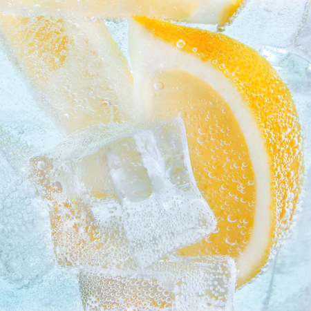 Drink with slices of lemon and ice. Soda cocktail tonic