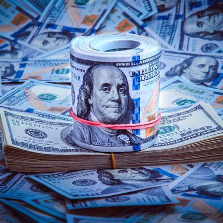 A pile of one hundred US banknotes. Cash of hundred dollar bills, dollar background image. 免版税图像