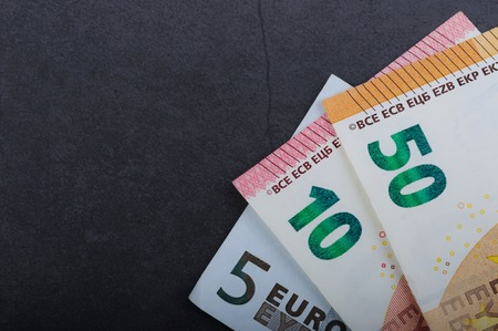 Euro bills. Different denominations on a gray background. 5, 10 50 euros