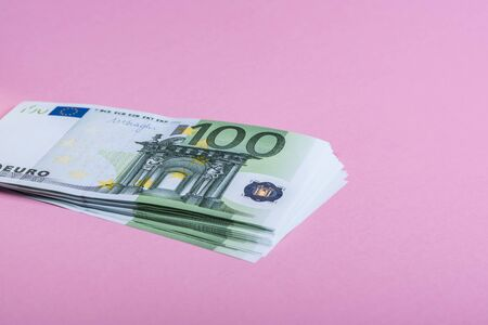 Euro cash on a lilac, purple and pink background. Euro Money Banknotes. Euro Money. Euro bill. Place for text. Banco de Imagens