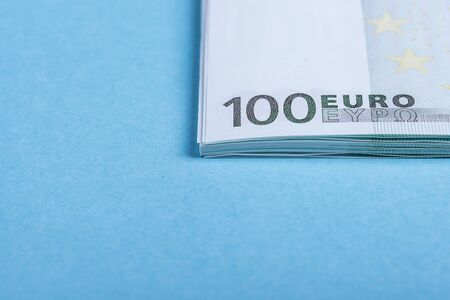 Euro cash on a blue and pink background. Euro Money Banknotes. Euro Money. Euro bill. Place for text.