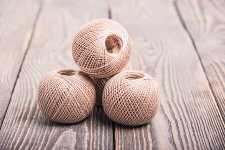 Balls of yarn thread for knitting on a wooden background Stock Photo