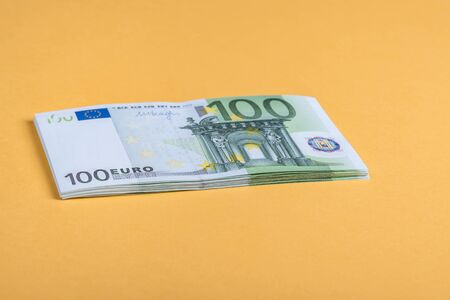 Euro cash on a yellow background. Euro Money Banknotes. Euro Money. Euro bill. Place for text