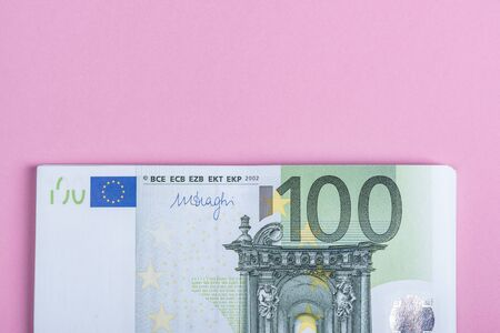 Euro cash on a lilac, purple and pink background. Euro Money Banknotes. Euro Money. Euro bill. Place for text