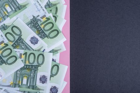 Euro cash on a pink and black background. Euro Money Banknotes. Euro Money. Euro bill. Place for text. Imagens