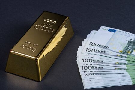 Euro cash and gold bar on a black background. Banknotes. Money. Bill. Ingot. Bullion.