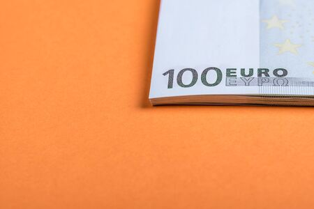 Euro cash on a pink and orange background. Euro Money Banknotes. Euro Money. Euro bill. Place for text