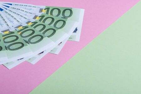 Euro cash on a pink and green background. Euro Money Banknotes. Euro Money. Euro bill. Place for text Imagens
