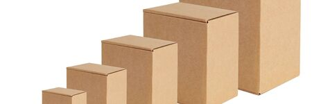 Cardboard boxes of various sizes are arranged in a row diagonally. Isolated on a white background