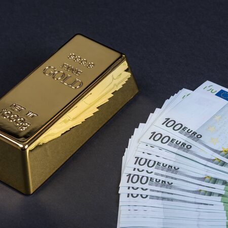 Euro cash and gold bar on a black background. Banknotes. Money. Bill. Ingot. Bullion Stock Photo