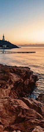 Landscape sea, rocks, sky church lighthouse pier