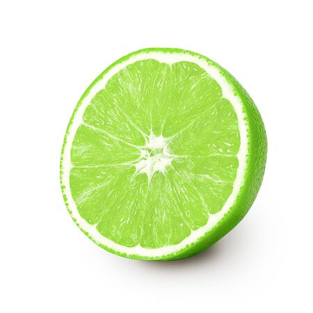 Isolated lime. One half ripe lime isolated on a white background. Located on its side, a ripe juicy, bright flesh of green color with texture and fibers is visible. Object with a small shadow.