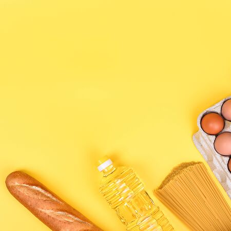Various food items on a yellow background. Delivery, donation, coronavirus, copyspace. Foto de archivo