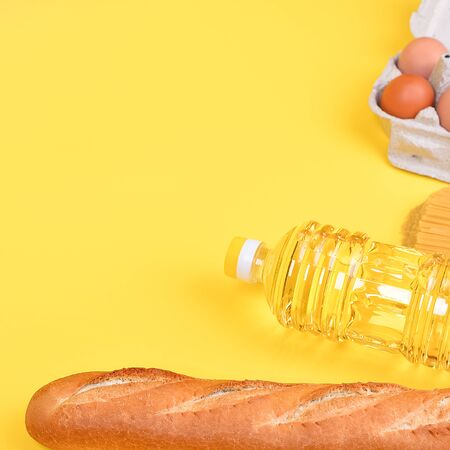 Various food items, fruits and vegetables on a yellow background. Copyspace. Banque d'images