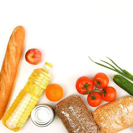 Food delivery, donation, food supply, copyspace. On a yellow background, buckwheat, peas, canned food, tomatoes, cucumber bread orange apple eggs package coronavirus quarantine Reklamní fotografie