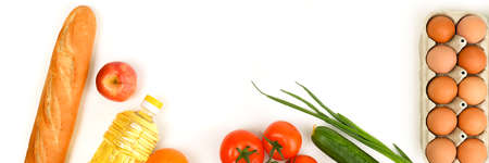 Various food items, fruits and vegetables on a white background. Copyspace.