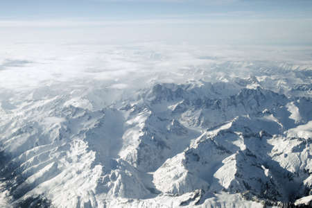 Alps from 30,000 feet. High altitude skies, jagged pinnacles and panoramic wilderness summits of this pristine mountain environment. photo
