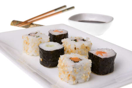 Sushi rolls, wooden chopsticks and soy sauce. Isolated on white Stock Photo - 6568335
