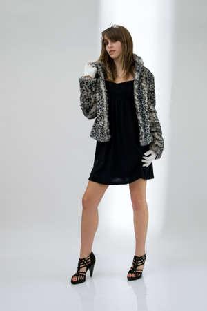 Fashionable teenager girl posing photo