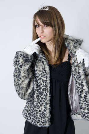 Fashionable teenager girl in fur coat photo