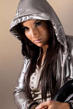 hoody: Women wearing electric hoody. Studio shot