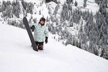 deep powder snow: Snowboarder standing in the deep powder snow