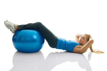 crunches: Young women doing crunches on fitness ball. Isolated on white