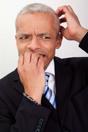 Stressed Businessman Biting His Nails photo