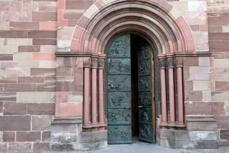 half open: Entrance to gothic style church. Southwest Germany.
