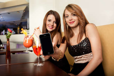 drinks after work: Showing mobile phone