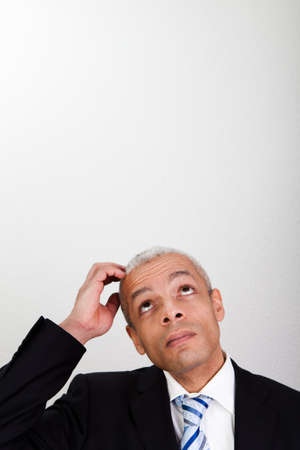 Businessman looking up photo