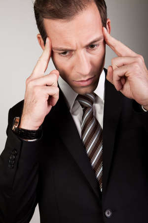 Young Businessman Is Thinking Hard Stock Photo - 8559374