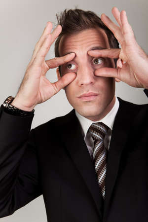 freaked: Businessman trying to stay awake Stock Photo