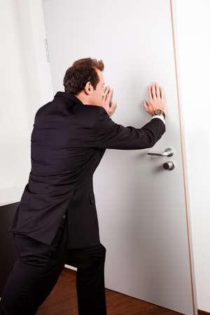 out door: Businessman pushing the door Stock Photo