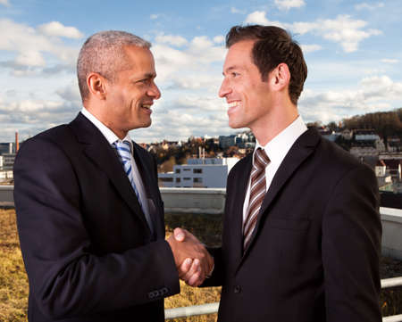 businessmen shaking hands: Business handshake over the deal Stock Photo